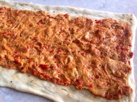 Place the tomato dough over