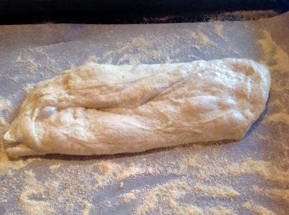 Small piece of dough stretched gently