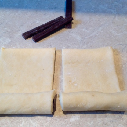(3) Roll dough over the chocolate