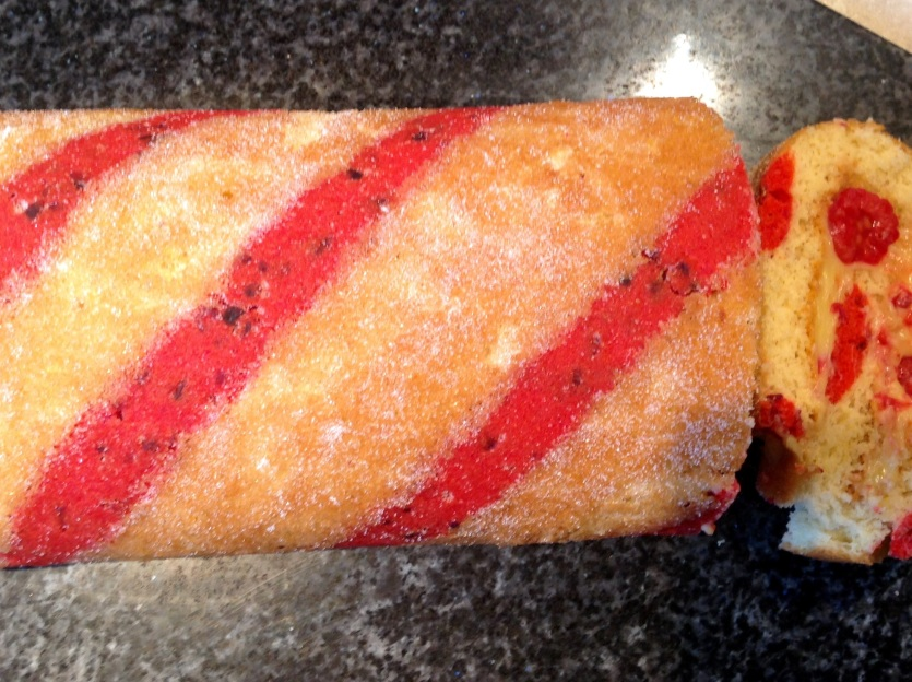 Passionfruit and raspberry swiss roll