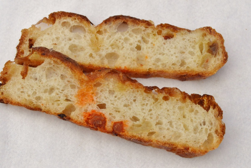 open crumb structure of roasted onion, chorizo & Parmesan focaccia