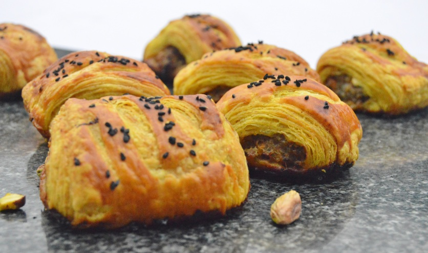 spiced lamb & pistachio rolls in a spiced rough-puff