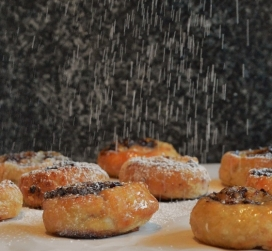 Cherry, walnut & maple syrup pastries with a liberal dusting of vanilla icing sugar