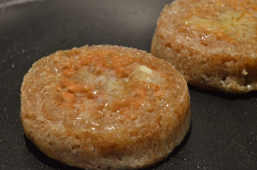 wholemeal sourdough crumpets straight out of the pan: buttered & ready to eat
