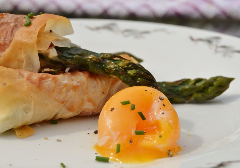 Asparagus wrapped in phyllo: this time with goats cheese inside, with poached egg yolk to dip into