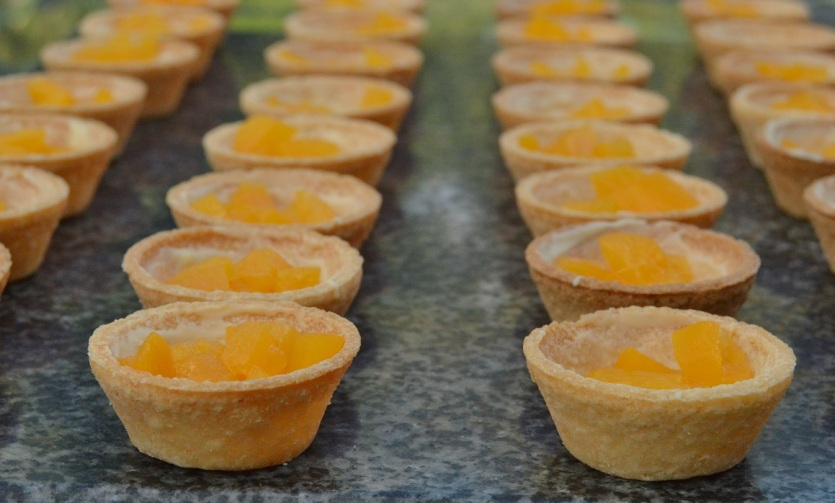 rum-soaked peaches in base of each tart case