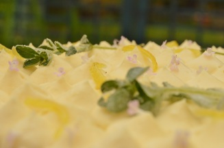 Lemon & thyme drizzle layer cake up close