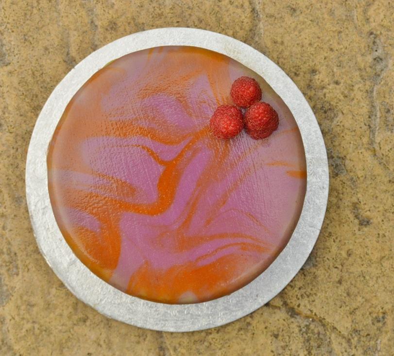 blood orange and raspberry cake with mirror glaze