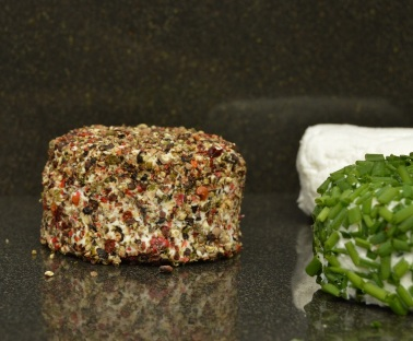 home-made goats' cheese: with chillies and peppercorns