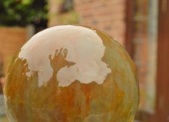 mirror glazed planet cake: lemon sponge and white chocolate buttercream interior