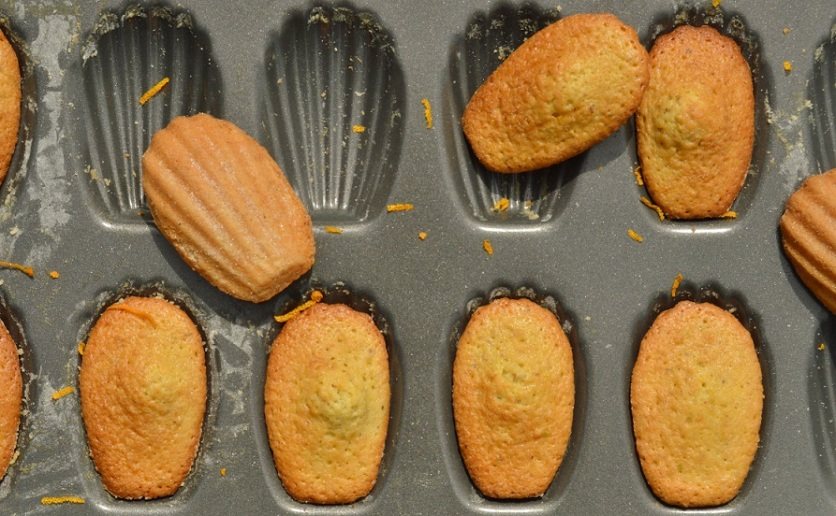 orange and pistachio madeleines