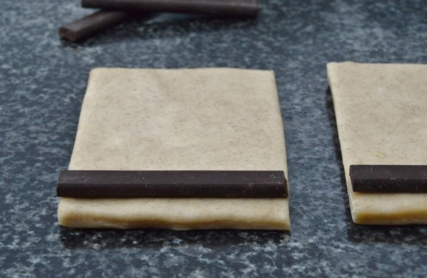 (I) Place chocolate near one edge