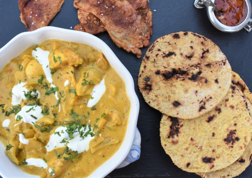 hot Coronation chicken with spiced flatbreads