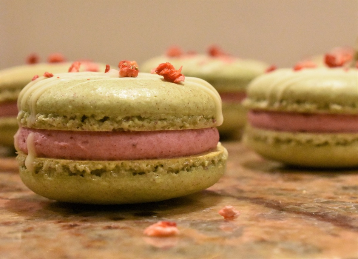 Pistachio and strawberry macarons